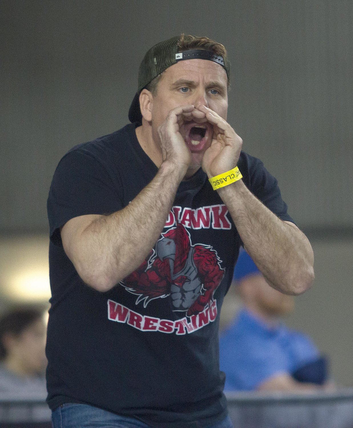 Assistant coach James Caldwell encourages his son, Kyle, during a Class 1A 195-pound match Feb. 16 at the Tacoma Dome.