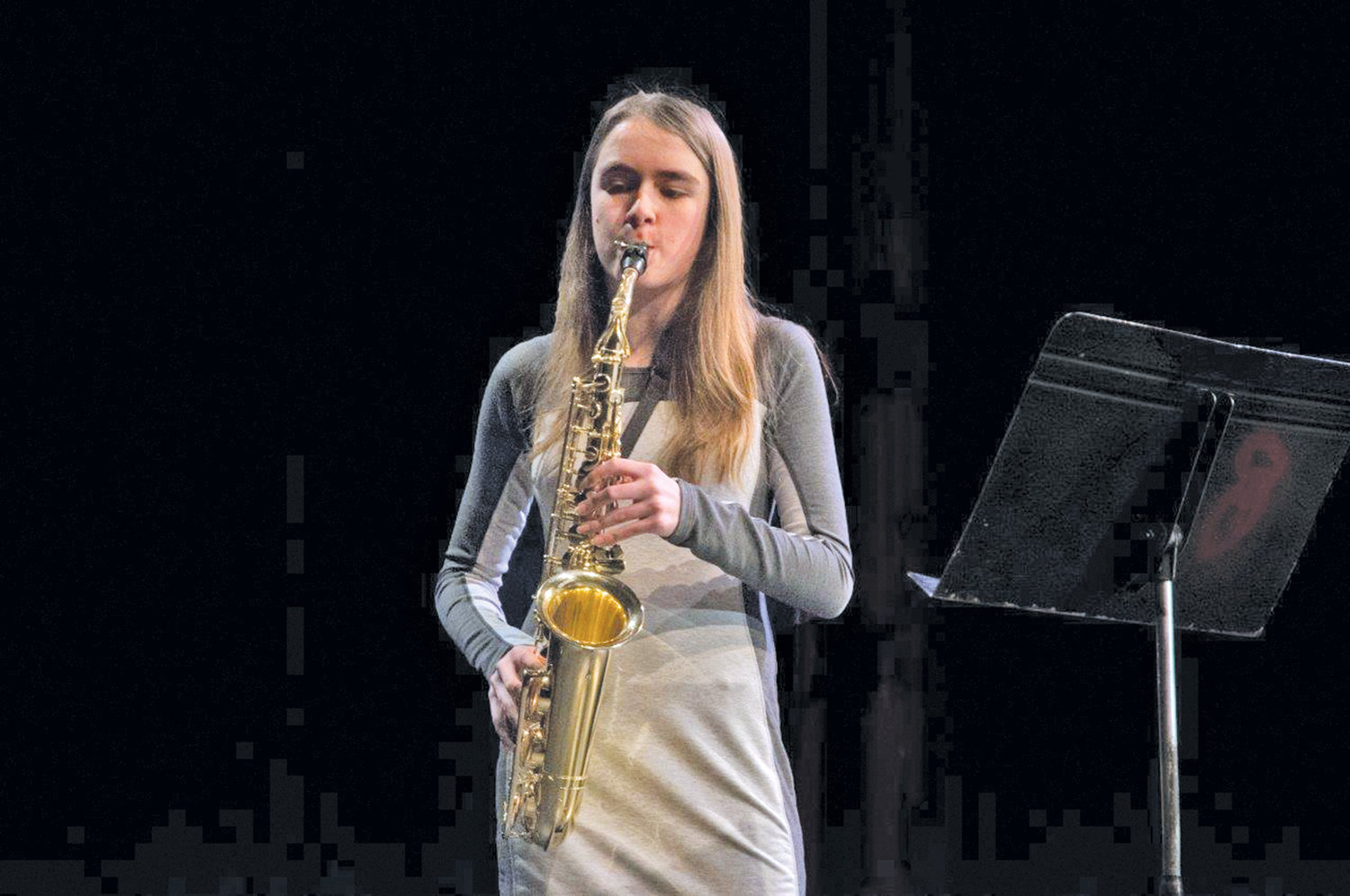 "In the junior division, first place went to Maria Powell, a home-schooled eighth-grader, for playing on saxophone ""Andanta and Allegro"" by Aude Chailleux."