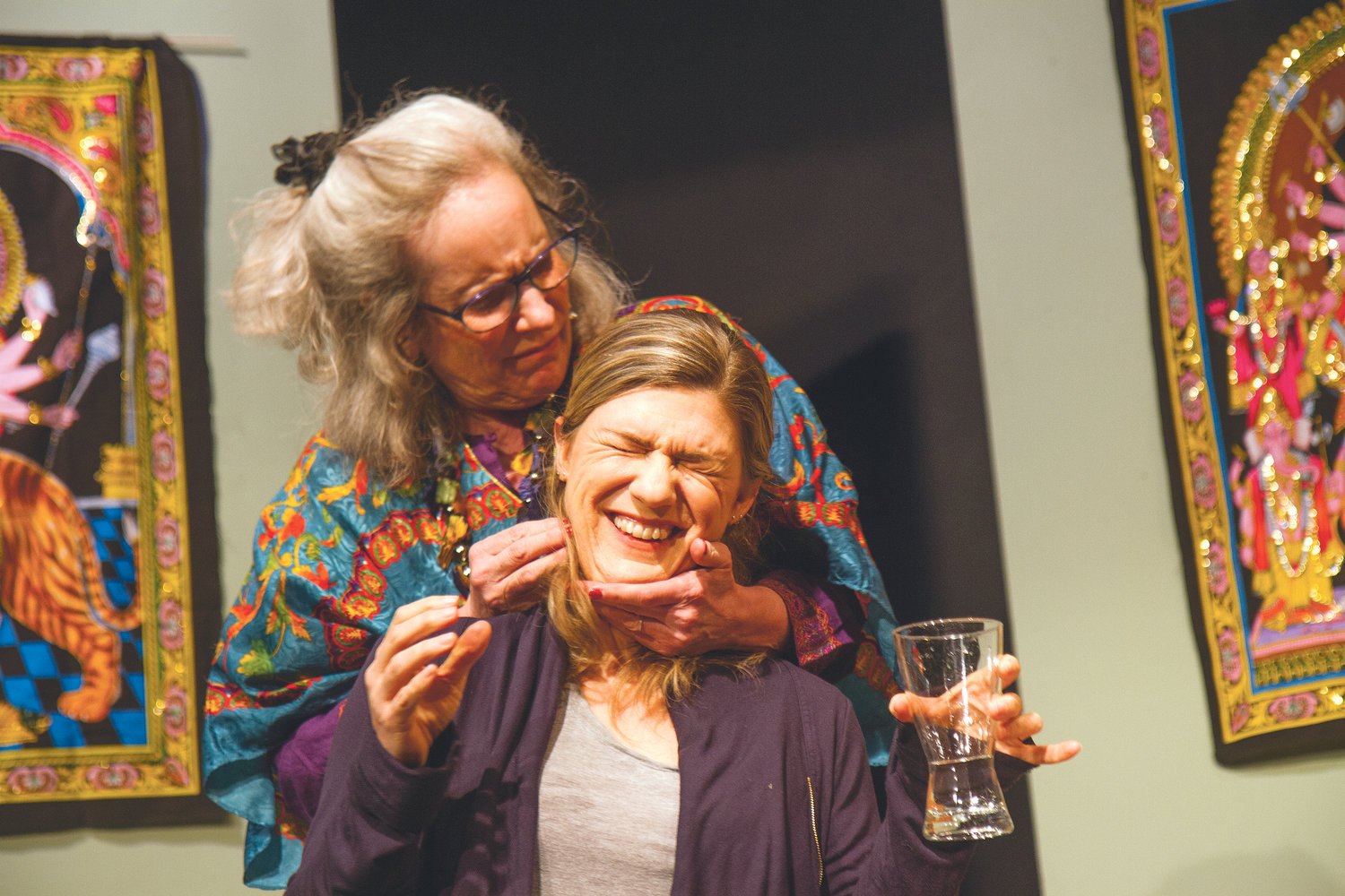 "Karen Anderson, as Lisa, winces as Judith Glass Collins, portraying her mother, embraces her from behind during a dress rehearsal of ""Karma Descending."""
