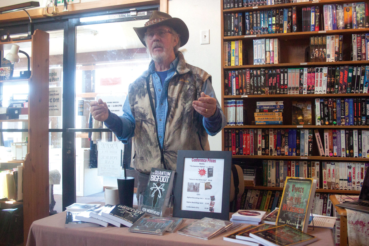 Sequim's Ron Morehead recounts his encounters with Sasquatch to an audience at the Olympic Trading Post in Chimacum March 2, occasionally playing recordings of what he believes to be Bigfoot calls.