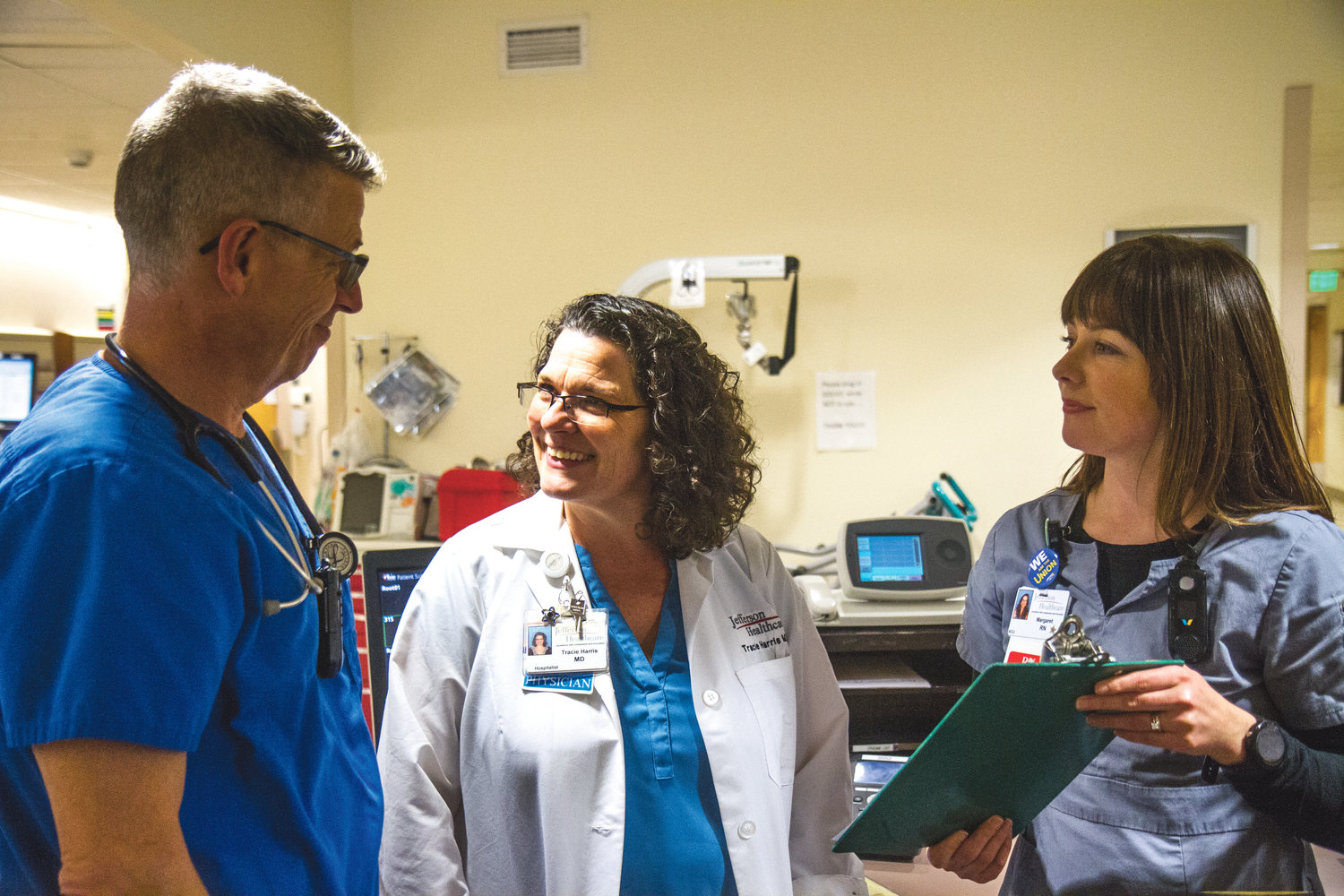 Ray Borgen, registered nurse, left, Dr. Tracie Harris, MD, Jefferson Healthcare chief of medicine. and Margaret Gourley discuss their patients.