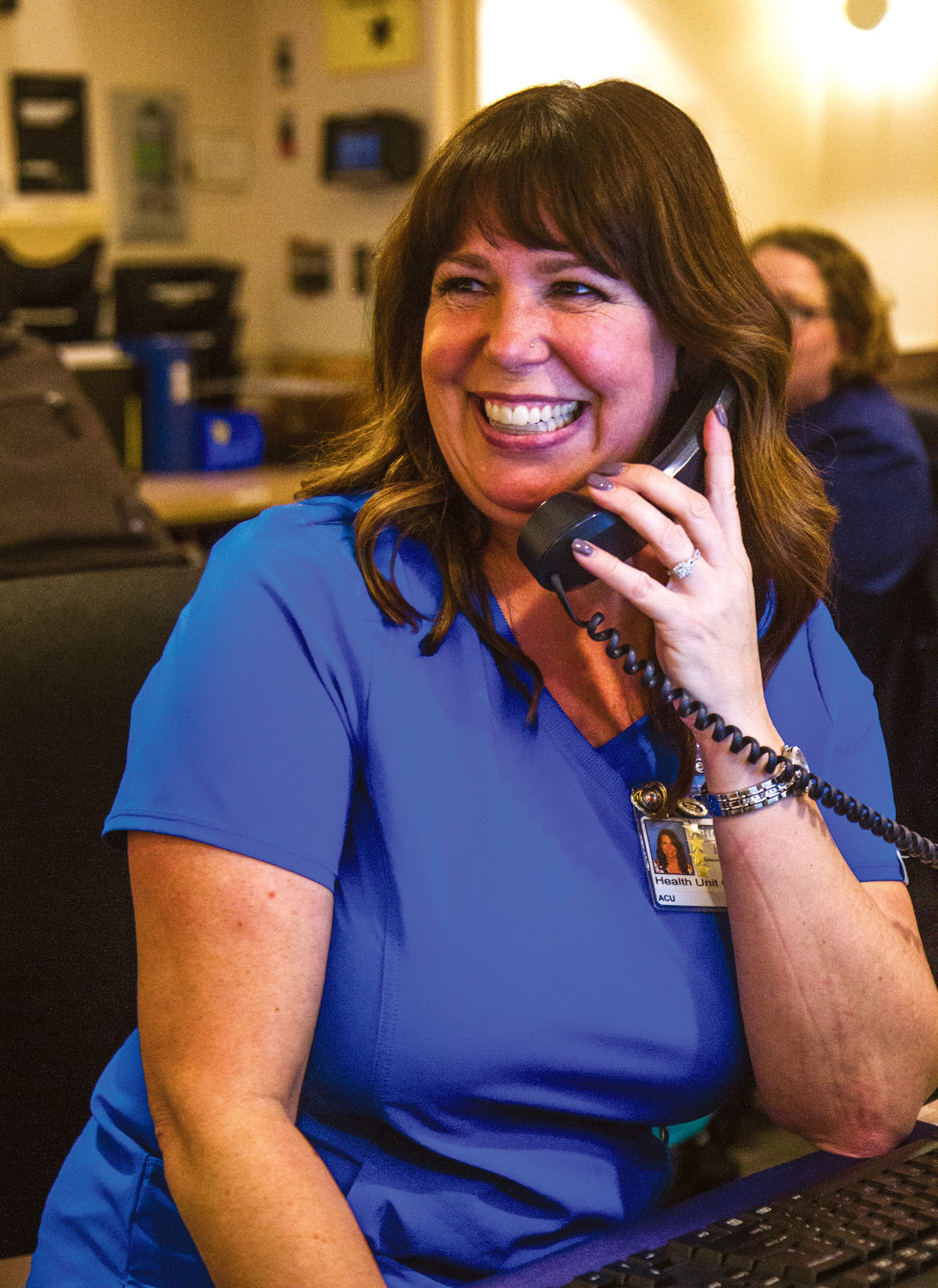 Corinna Clemens, Jefferson Healthcare health unit coordinator for the acute and intensive care units, takes a phone call at her station.