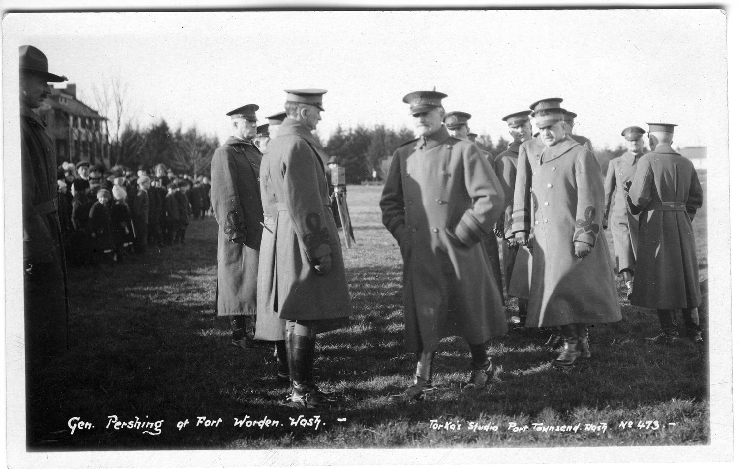 "General of the Armies John ""Blackjack"" Pershing, with his hands in his pockets, after inspecting the troops at Fort Worden (January, 1920). The children, poised to run onto the Parade Ground, anxiously await the general's permission."