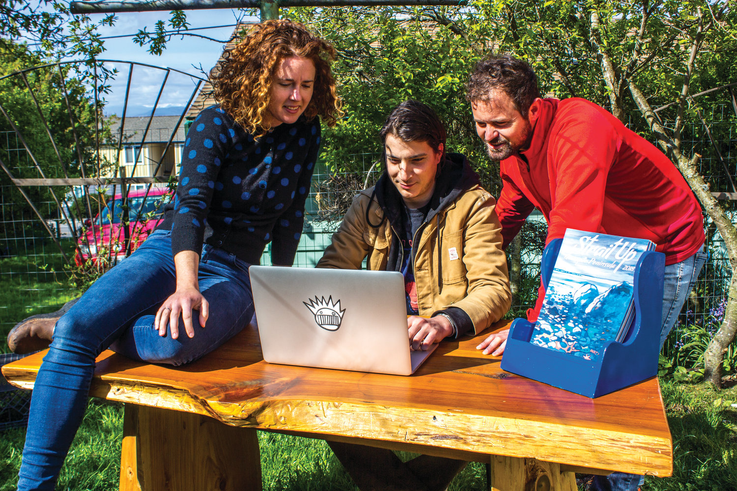 "Justine Gonzalez-Berg, from left, Chen Pollina and Danny Milholland have worked for several months to complete the latest edition of ""Strait Up Magazine."""