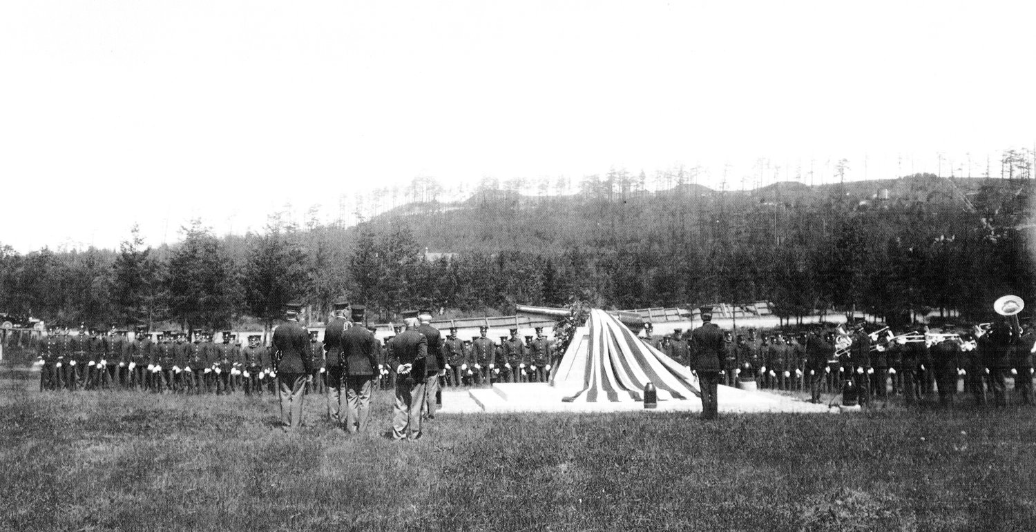 Fort Worden troops and the regimental band at Memorial Day observance (circa 1905) at the fort's military cemetery. Note: The wooden fence around the cemetery's perimeter, later replaced with an iron fence, is noticeable behind the soldiers in formation.