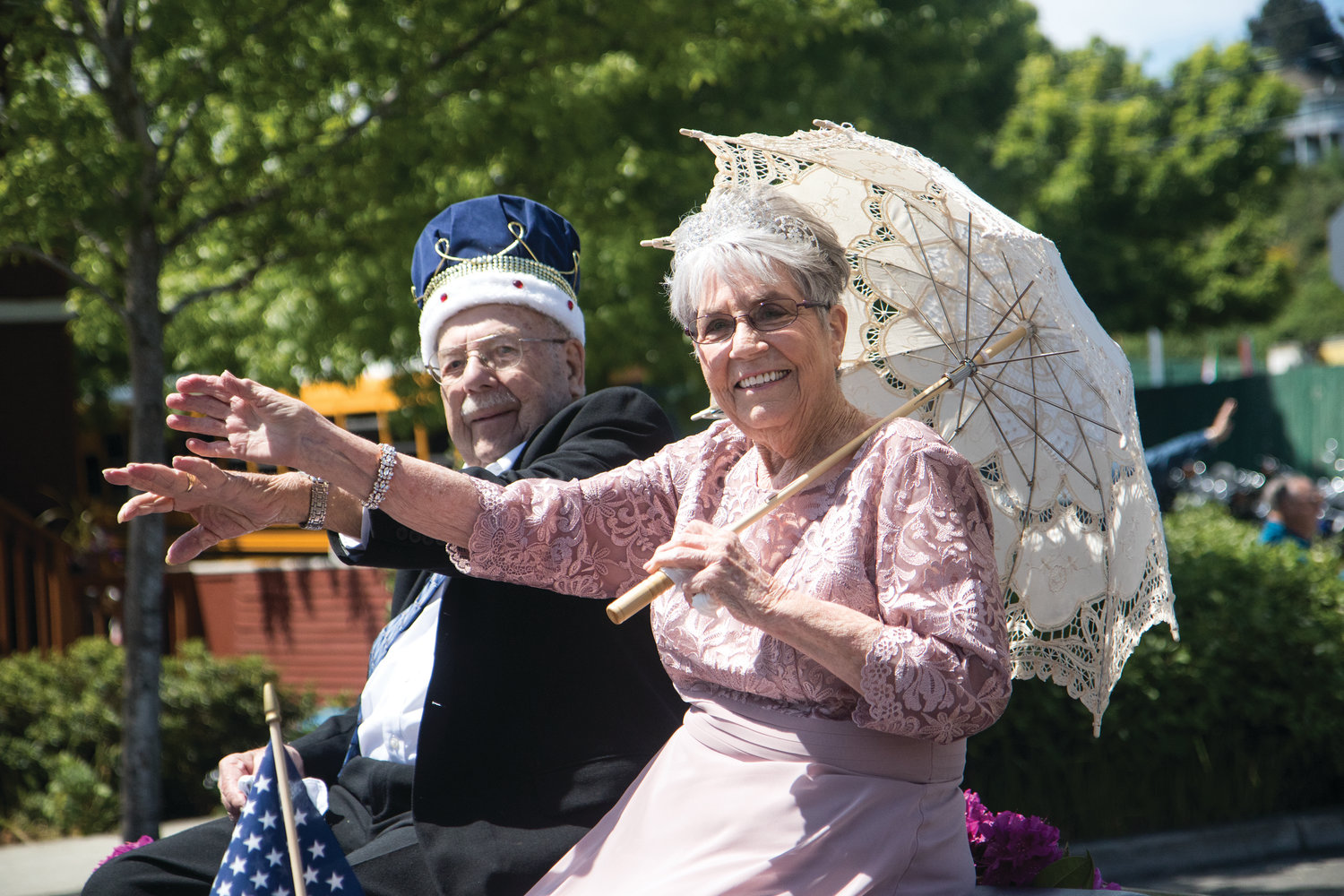 King Curt Russ and Queen Betty Grewell wave to the crowd at the Grand Parade, May 18. Russ and Grewell represented the Senior Royalty for the Port Townsend Senior Association.