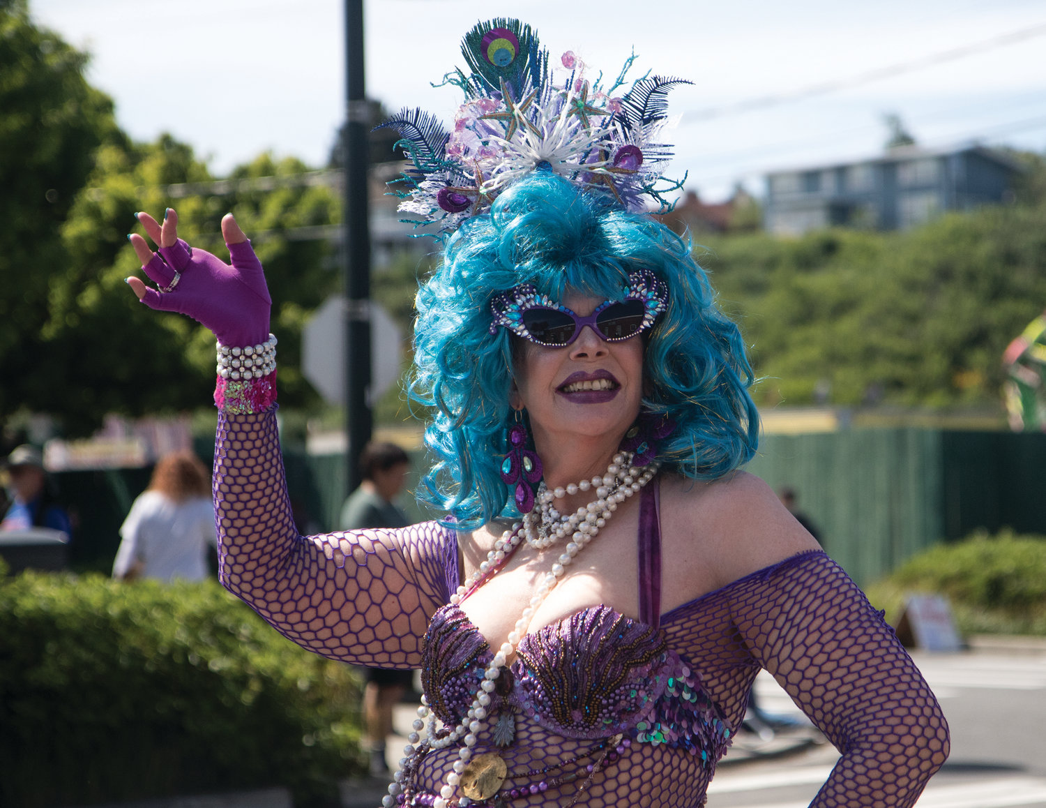 Lyn Hersey, dressed in a Mermaid Chic look, dances down the street with members of the International Pussy Alliance.