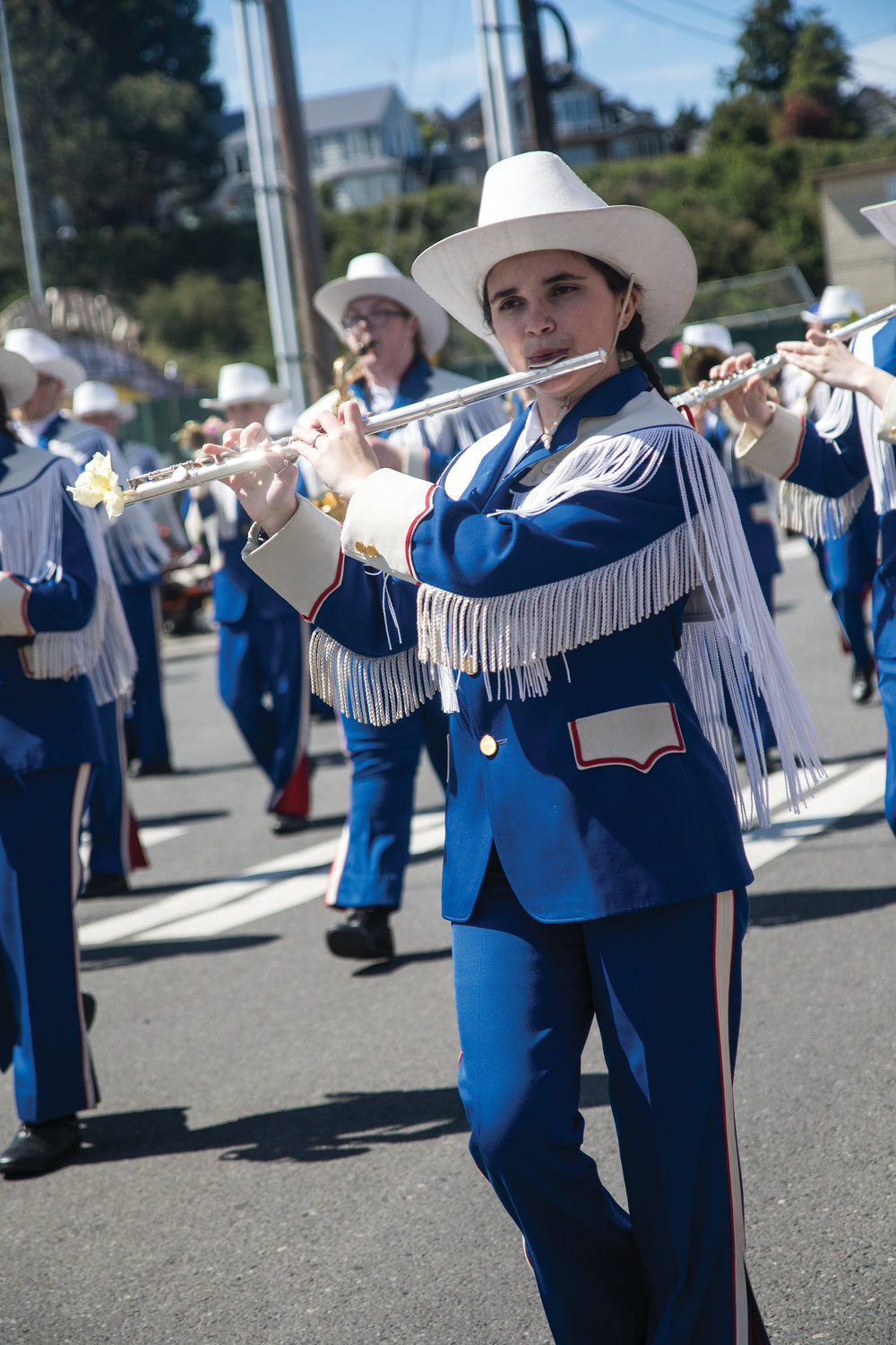 The Chimacum High School Marching Band played tunes down Monroe Street at the Grand Parade.