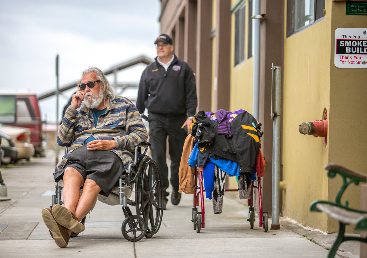 David Teske, 73, one of six evicted from his apartment on Water Street last week, waited patiently for a bus to take him to the Hadlock Inn where he will stay until new more permanent lodgings are found for him.