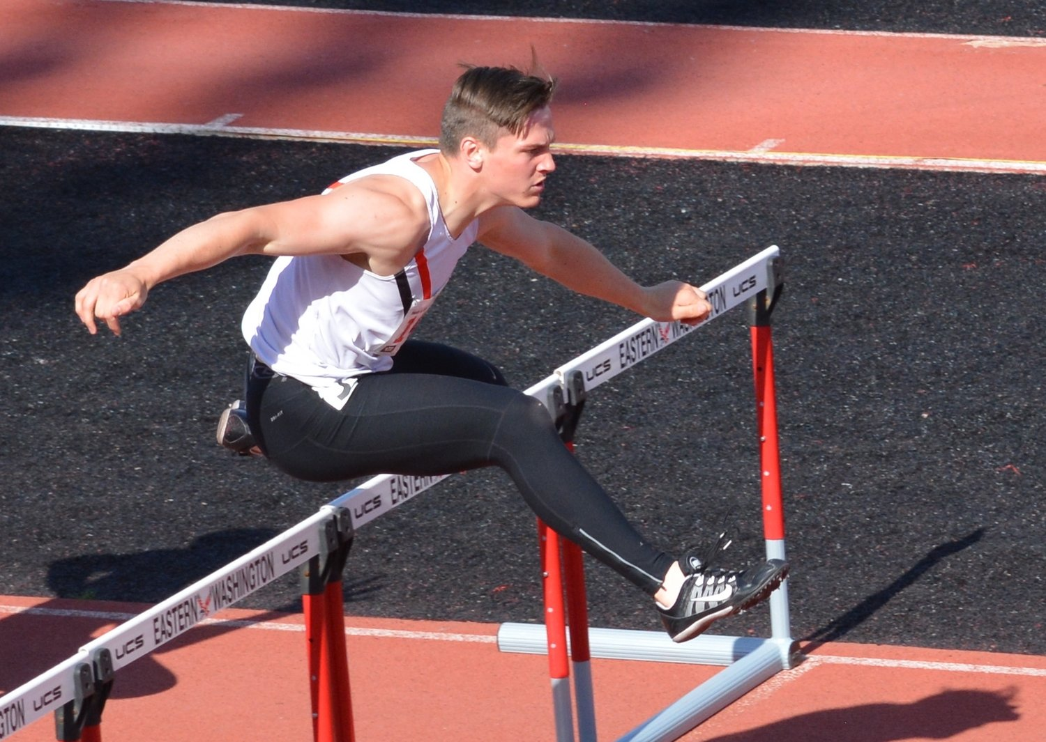 Dylan Tracer clears a hurdle. He competed in both men's hurdle events.