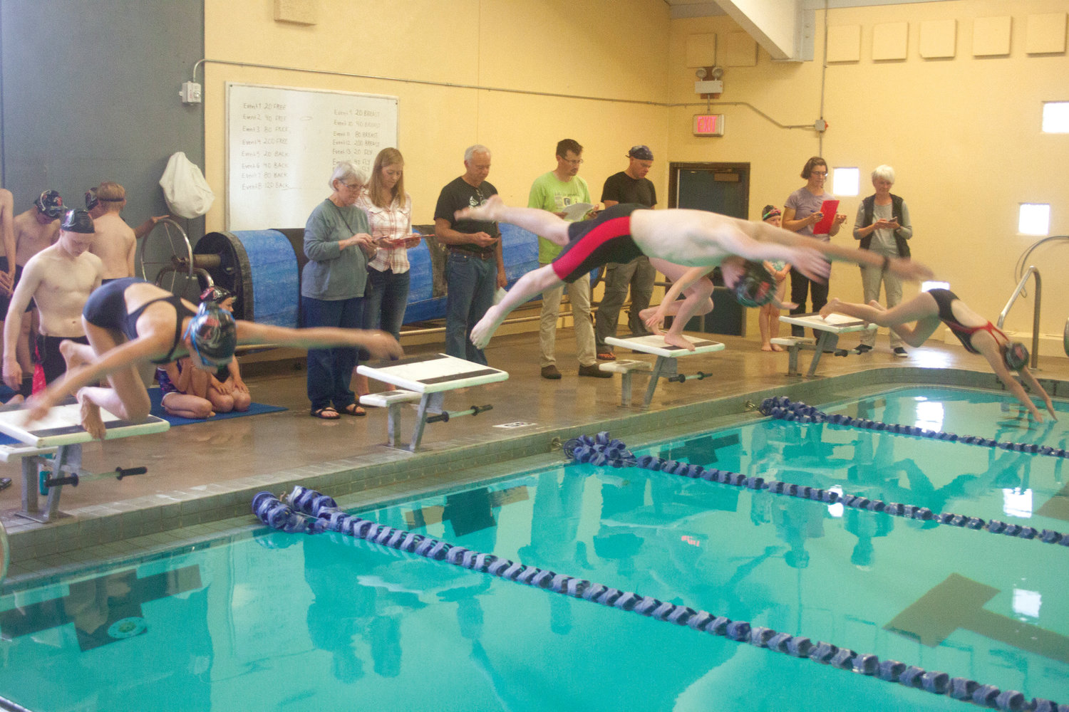 REDfins swimmers dive into the Mountain View campus pool May 24.