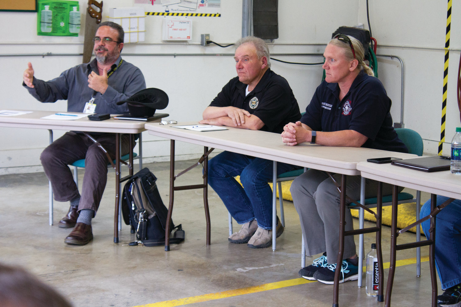 JeffCom Director Karl Hatton, left, addresses the community June 5 at the Port Ludlow Fire and Rescue Station 33 with fire personnel.