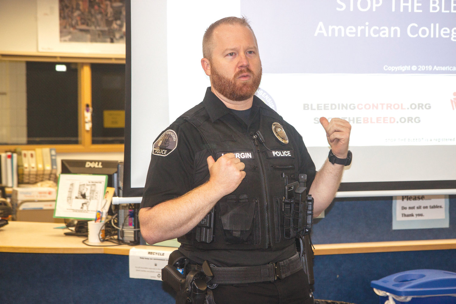 "Port Townsend Police Department School Resource Officer Jeremy Vergin participates in ""Stop the Bleed"" lifesaving training for the Chimacum School District June 17."