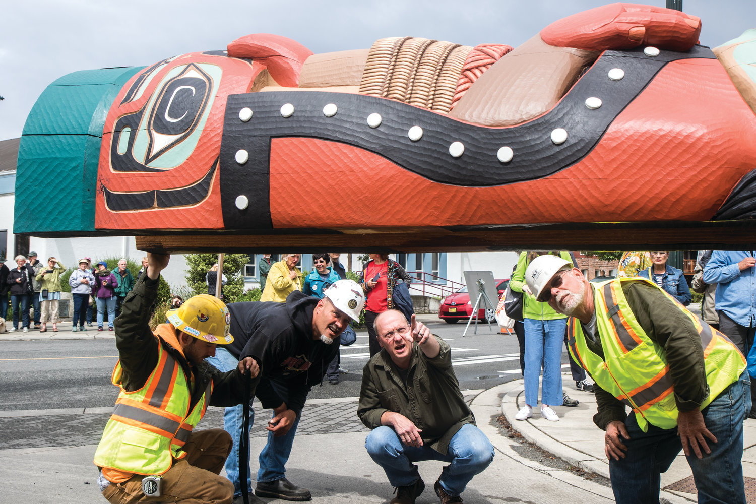 Bud Turner (center), manager of the Jamestown S'Klallam carving shed, works with Josh Cooper and Jerry Thompson of Jamestown Excavating to lift the 1,600 pound Totem Pole and mount it upright outside the Northwest Maritime Center. The pole was a gift from the Jamestown S'Klallam tribe and depicts the Supernatural Carpenter, the Spirit of the Western Red Cedar and Cicmehan on Sentinel Rock.
