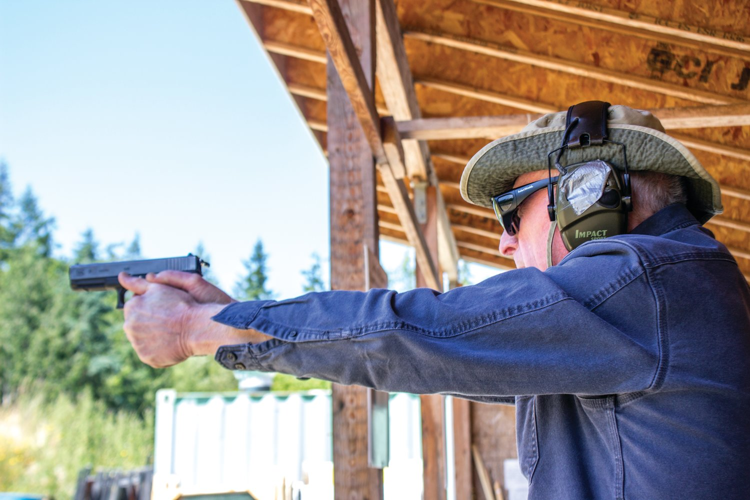 Jim Dolan, a club member for the past three years, shoots regularly at the range to retain his proficiency.