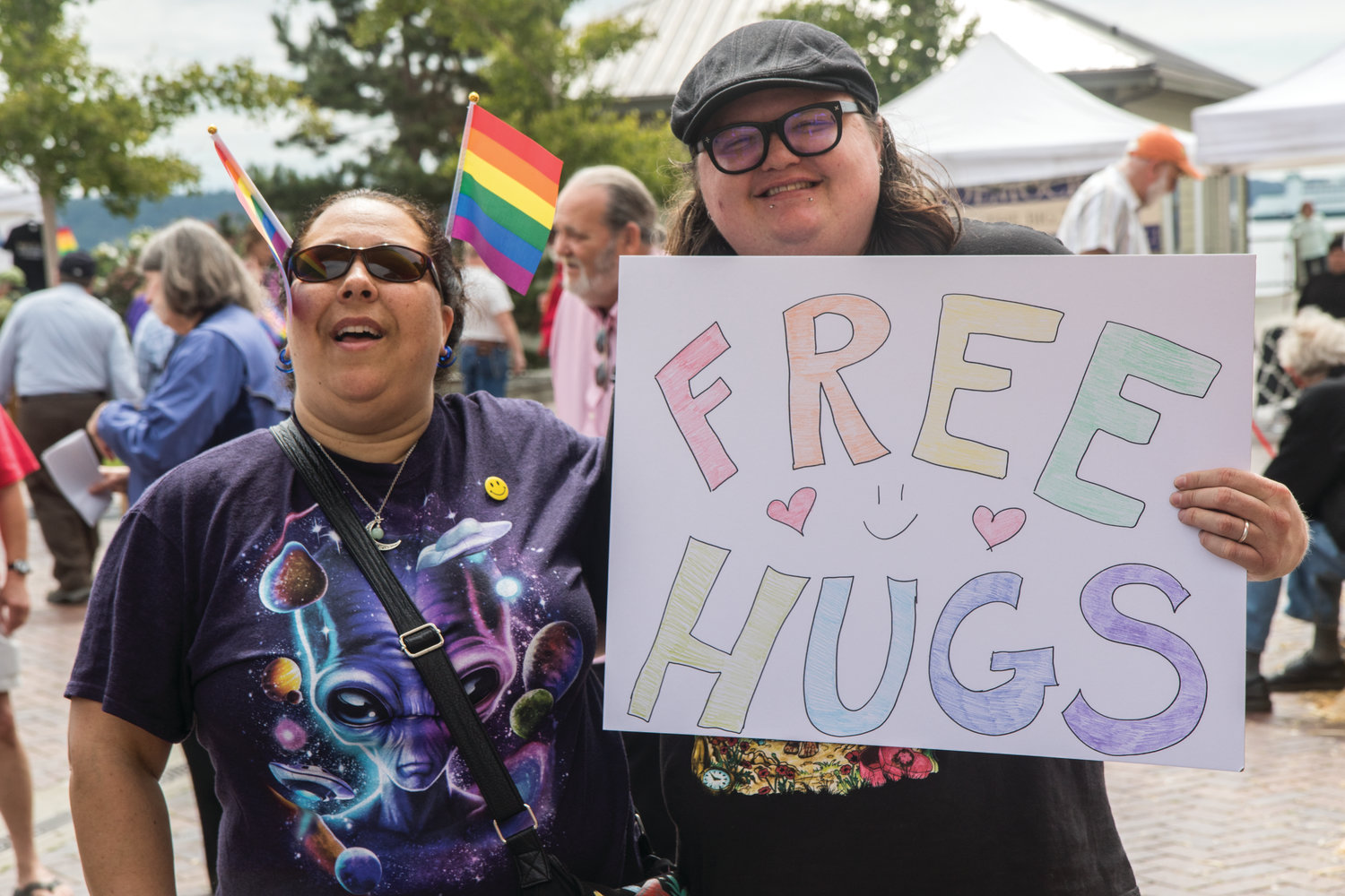 Ashlee Beach and Nina Slagle offer free hugs at Pride Fest in Port Townsend on July 13.