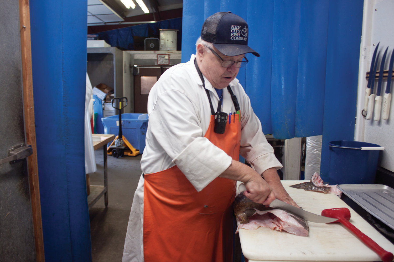 Key City Fish Company meat specialist Daniel Knudson and owner Johnpaul Davies choose the choicest cuts of fish.