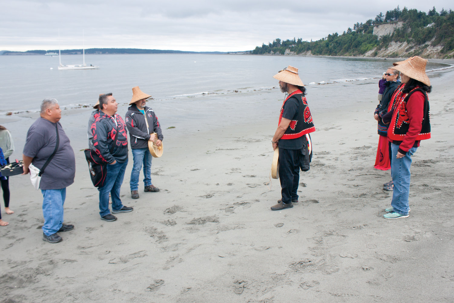 Tribal members greet one another on the shores of Fort Worden State Park July 17.
