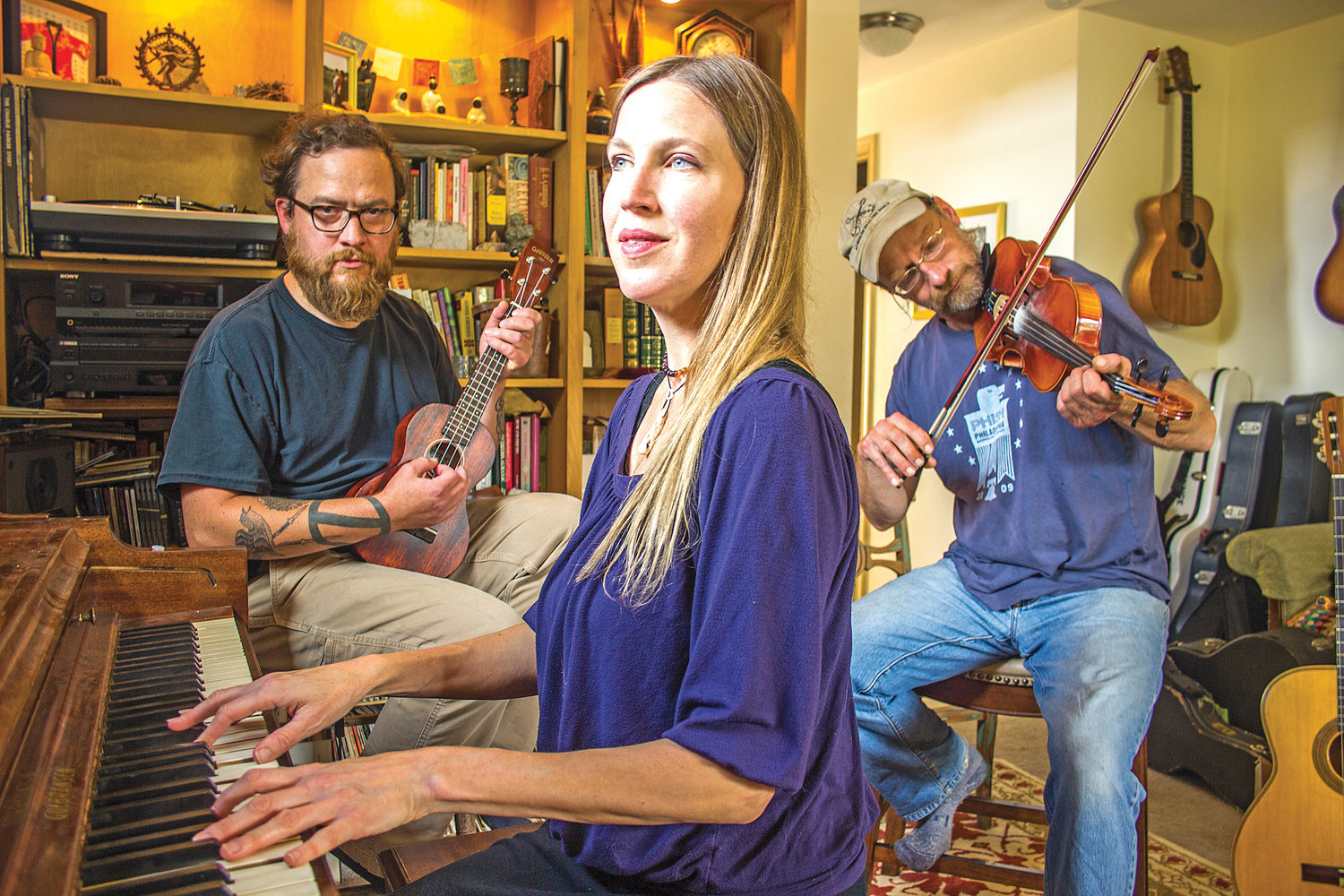 Janna Marit, center, Zach Parker, left, and Matt Sircely will perform with David Michael (not pictured) during an upcoming show in Port Townsend.