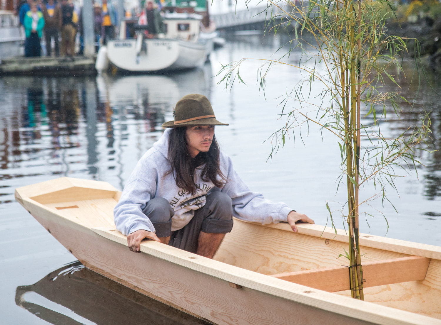 Gabriel Partridge, a student at the Northwest School of Wooden Boat Building in Port Hadlock, sits in the Japanese river boat he helped build with a class of nine fellow students.