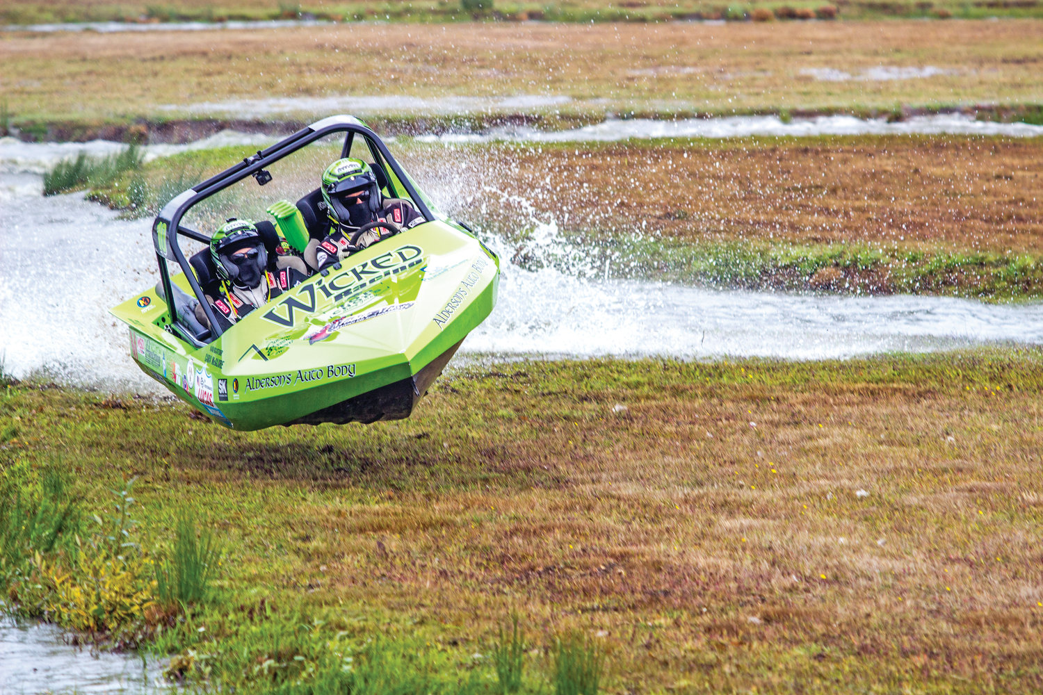 "Dan Morrison of Wicked Racing, at right, launches his boat into the air after hitting an island in the sprint boat course Sept. 7 at Extreme Sport Park Port Angeles at 2917 W Edgewood Drive. His navigator Cara McGuire hangs on for the ride. Morrison went on to win the ""unlimited category."" The American Sprint Boats Association is exploring the possiblity of opening up a new track in Jefferson County."