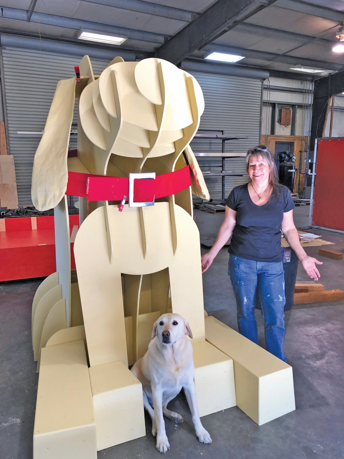 "Yacht interior designer Gwendolyn Tracy working right up to the last minute with the model ""Blazer"" and the sculpture. Tracy supplied the collar and found a Boat Haven craftsman to produce the buckle."