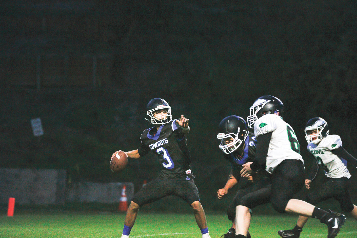 Making his homefield debut as Chimacum quarterback, Henry Brebberman guides the Cowboys to victory over the Klahowya Eagles 22-16 on Sept. 27.