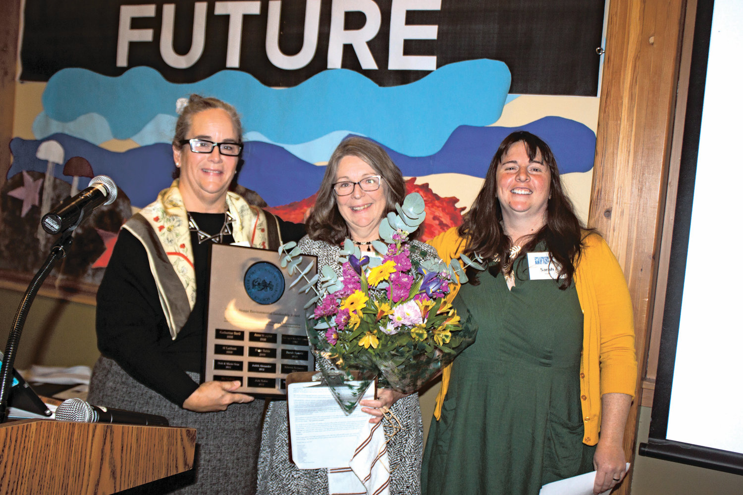 "Cheri Scalf, center, also known as ""godmother of the salmon,"" received the 2019 Eleanor Stopps Environmental Leadership Award by the Port Townsend Marine Science Center on Oct. 3."