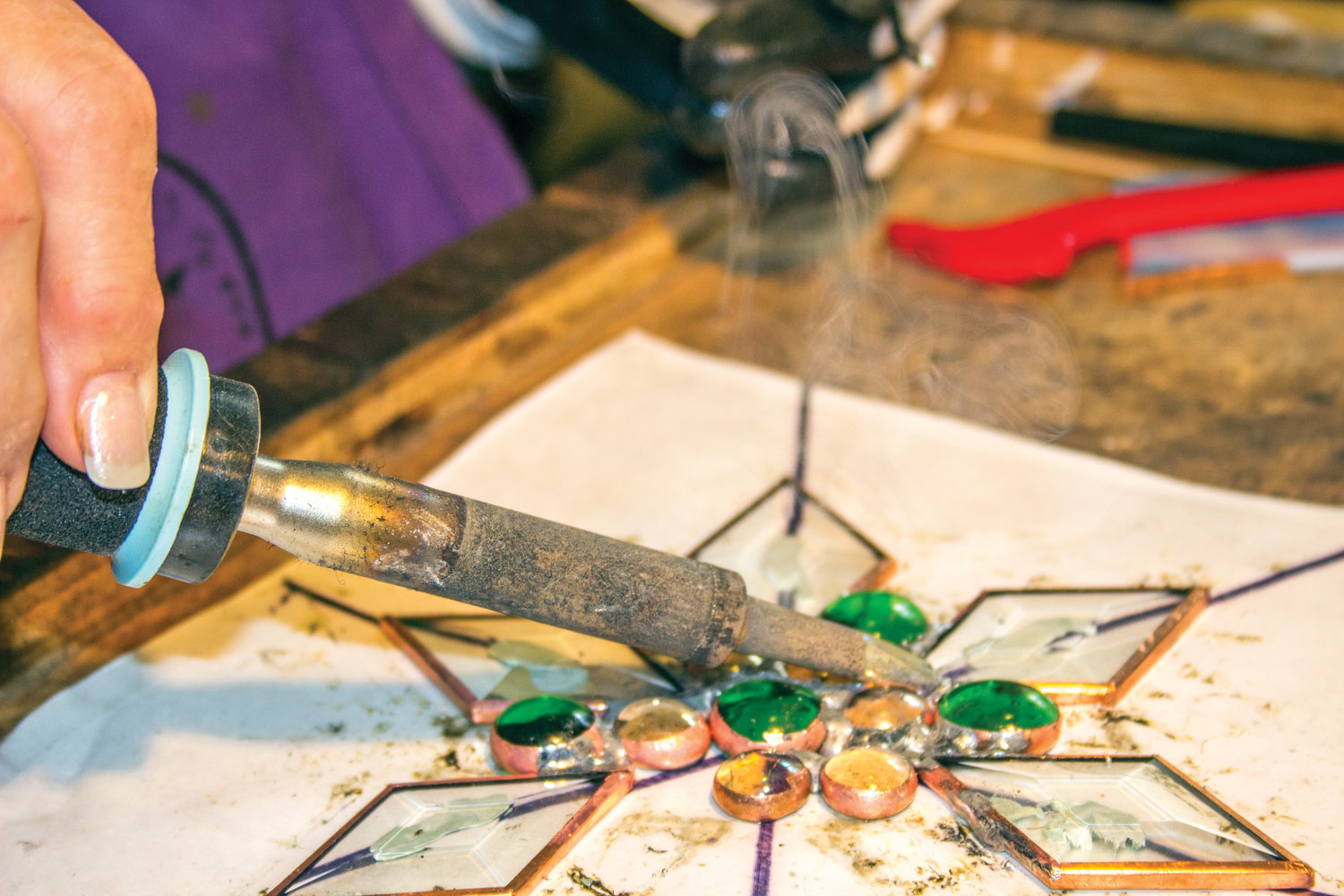 Pat Chase enjoys the soldering phase the most, and says mistakes can be used to create beautiful designs.