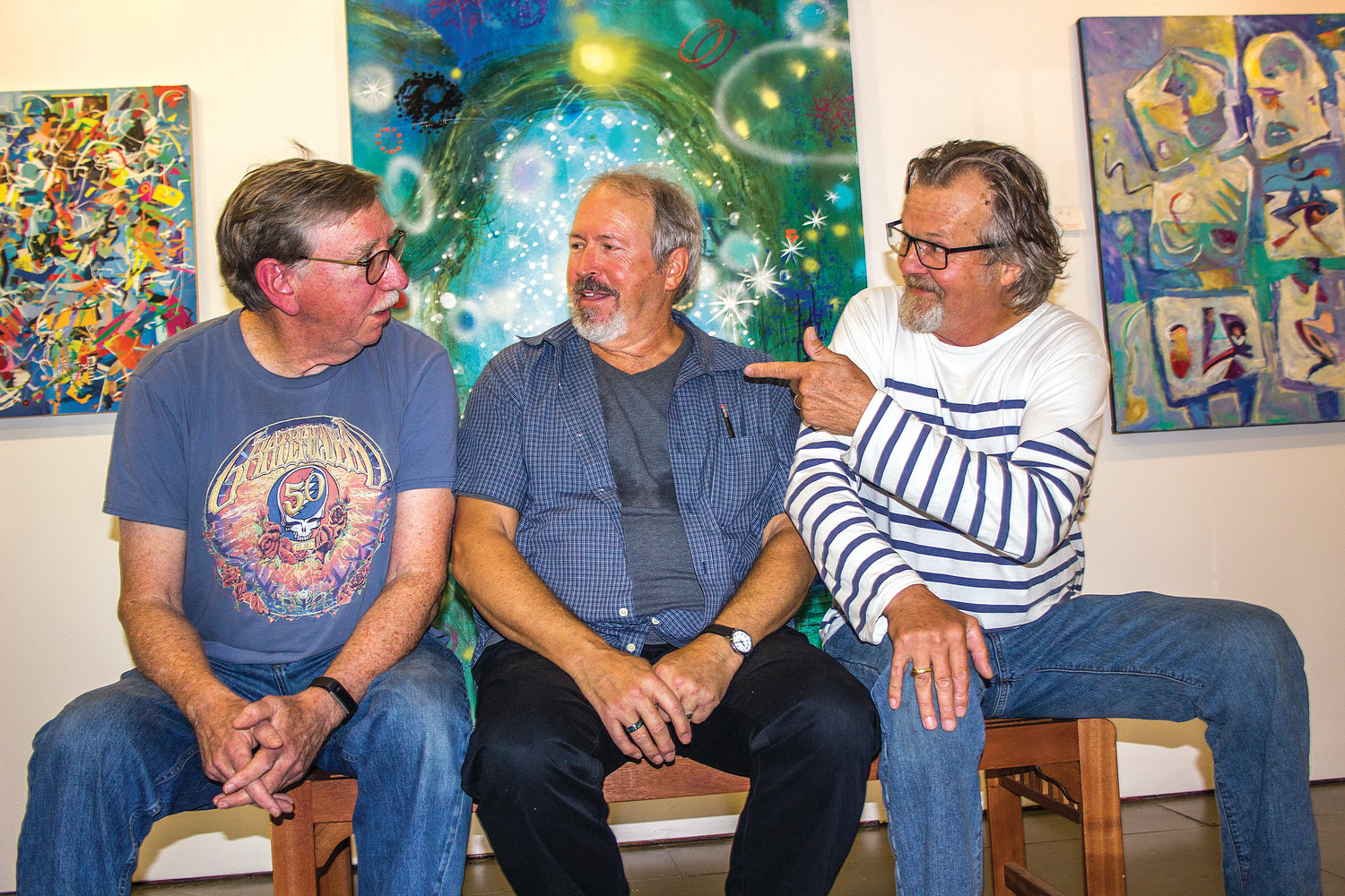 Stephen Yates, center, has been chosen as the 2019 Angel of the Arts recipient. He will be showing off a selection of his painting with fellow artists Harold Nelson, left, and Peter Juvonen at the art gallery at the Old Alcohol Plant.