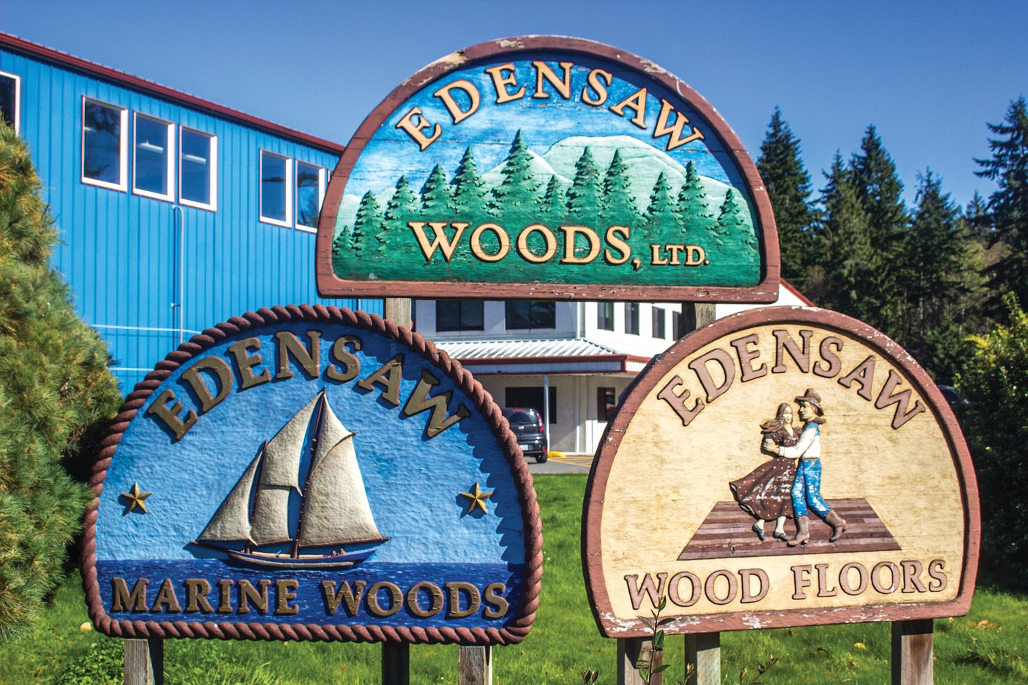 These signs at Edensaw Woods were carved by Stanley Rill.