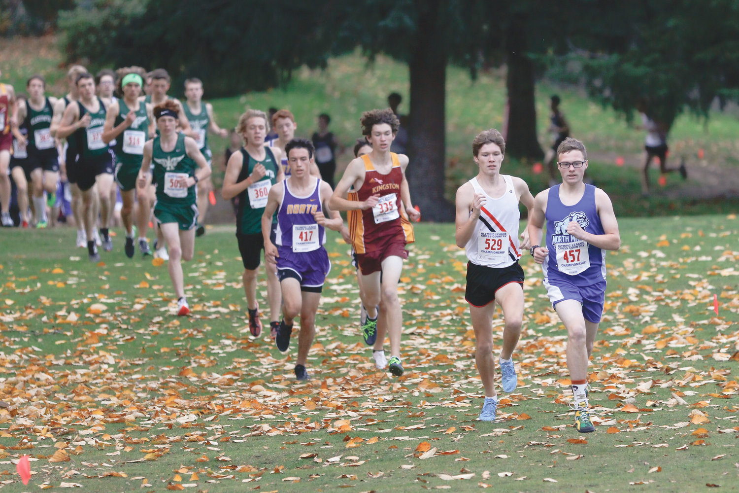 Nathan Cantrell hangs just behind a runner from North Mason, until he passes him in a final push.