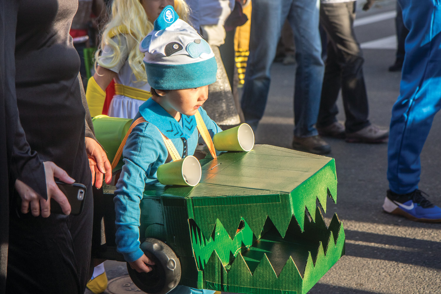 Four-year-old Asa Parker marches down the street as Captain Barnacles.