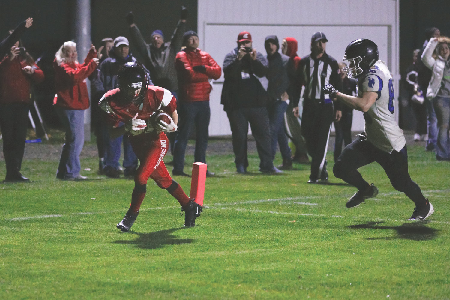 After catching the pass on a short slant route, Redhawk wide receiver Joshua Davis dances his way into the endzone for the win.