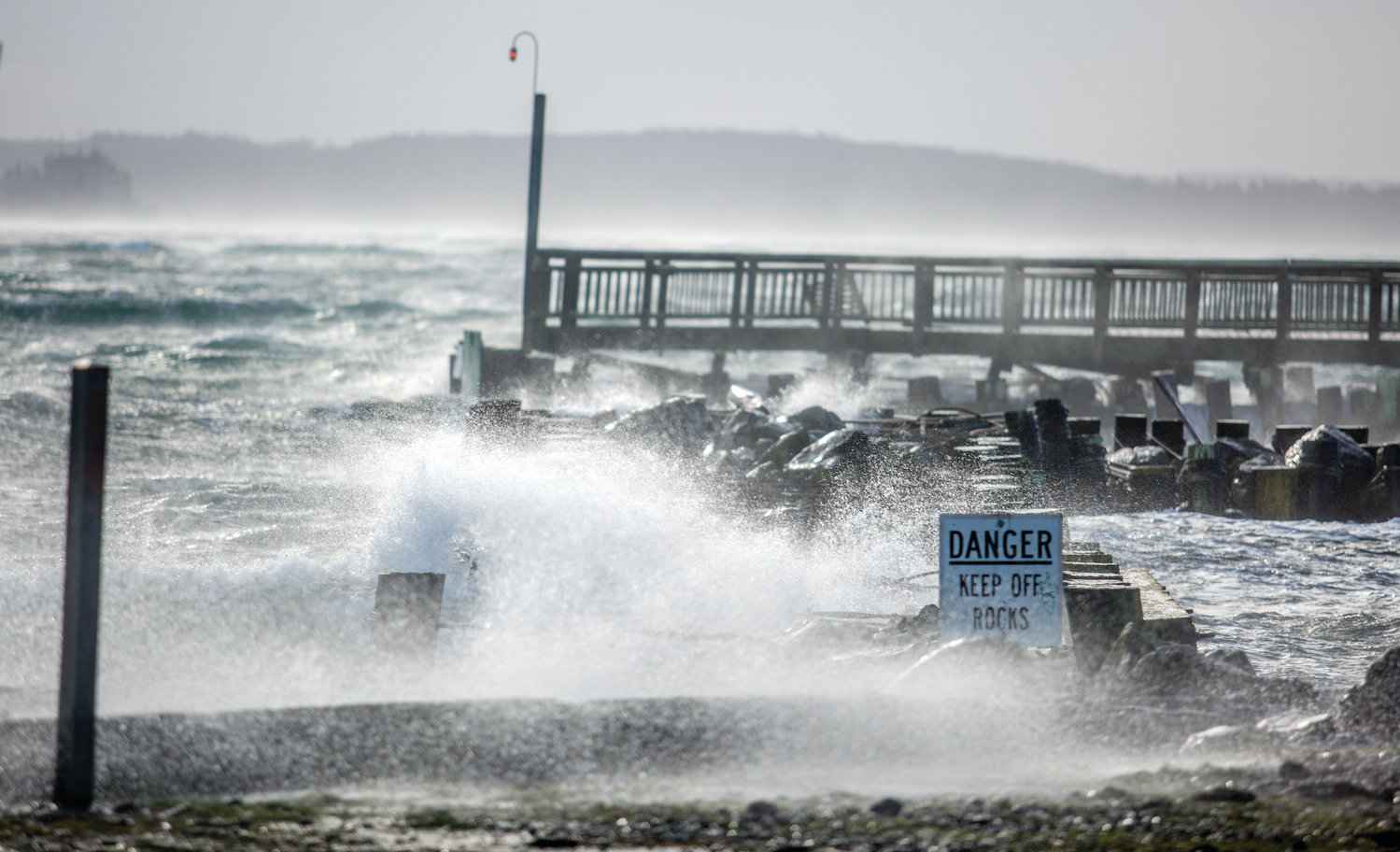 Waves crash over the Point Hudson jetty, which is in disrepair, during last year's memorable wind storm that coincided with a king tide on Dec. 20, 2018.