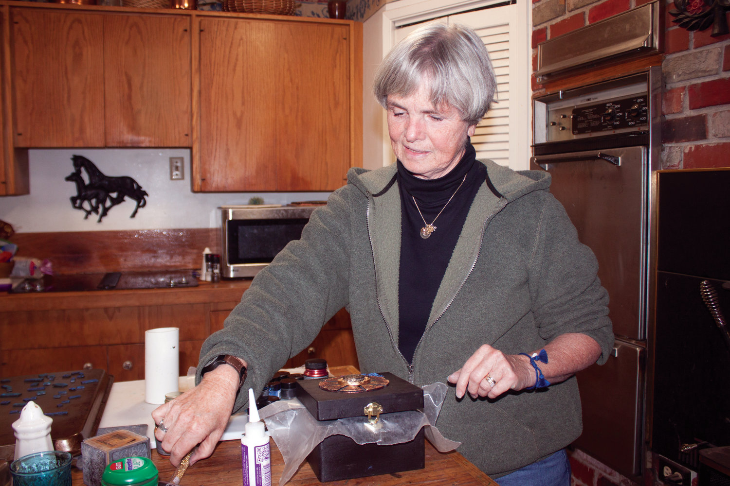 Nancy McDaniel works in her kitchen on one of the craftwork pieces she sells at multiple regional craft shows throughout the year.