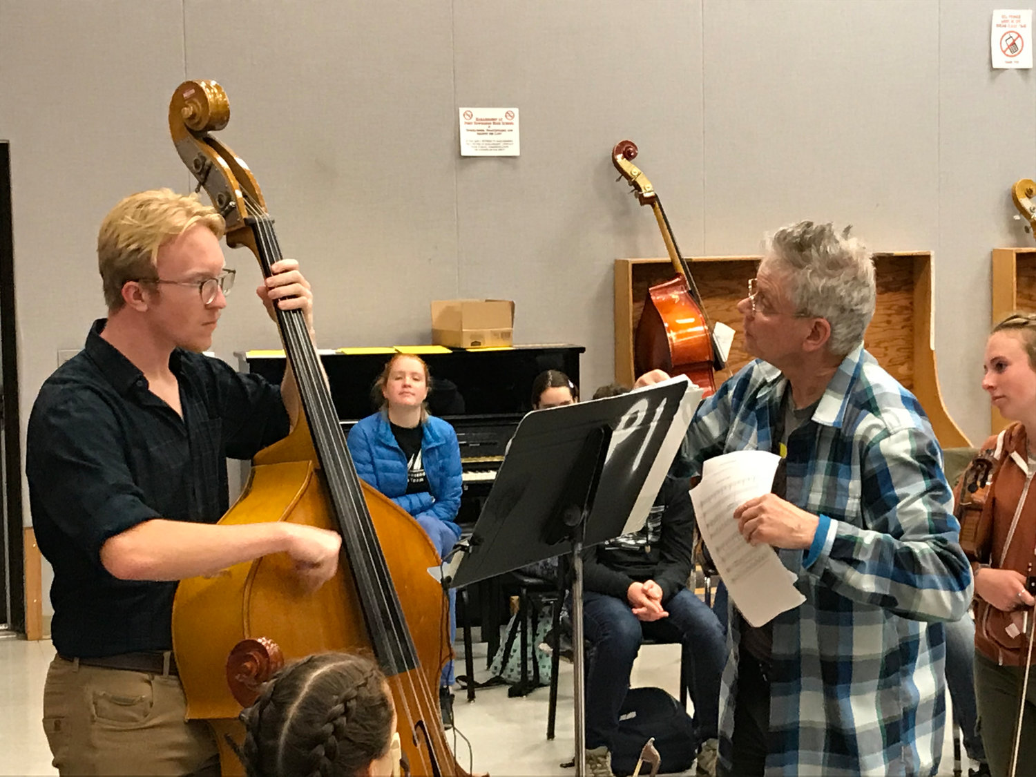 Orion Pendley, left, receives instruction from David Harrington of the Kronos Quartet at Port Townsend High School Nov. 5.
