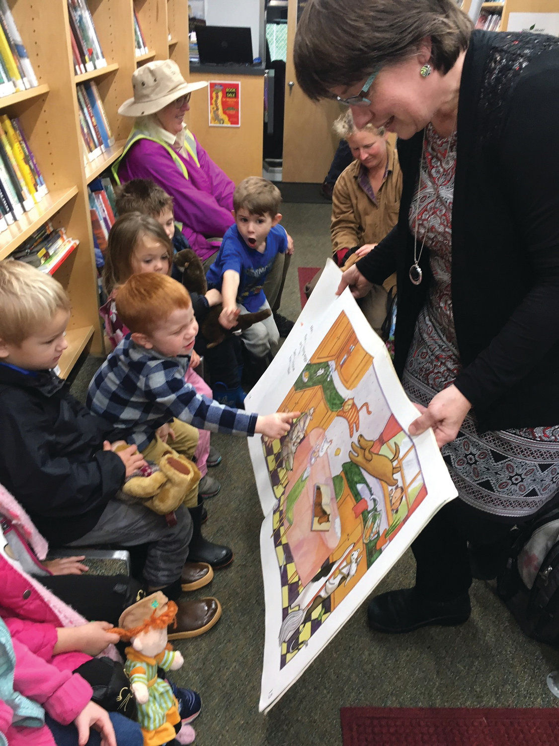 "Jefferson County Library Mobile Services Manager Celeste Bennett reading to the ""story time"" class during the Quilcene Preschool's weekly bookmobile visit Oct. 22."