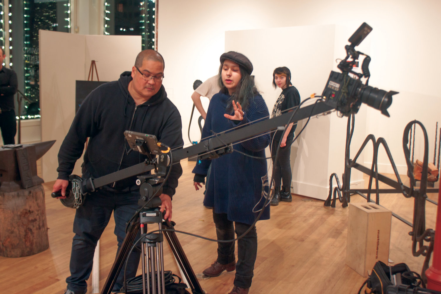 "Director of photography Brody Willis (left) receives guidance from ""She the Creator"" director Juliette Wallace on the positioning of the camera during their Nov. 18 shoot in Northwind Arts Center in Port Townsend."