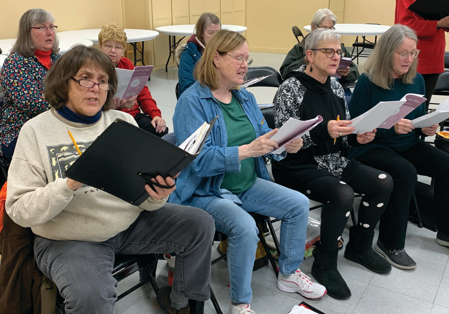 "Community Chorus singers practice in preparation for two weekend concerts, including ""A Bluegrass Mass."""