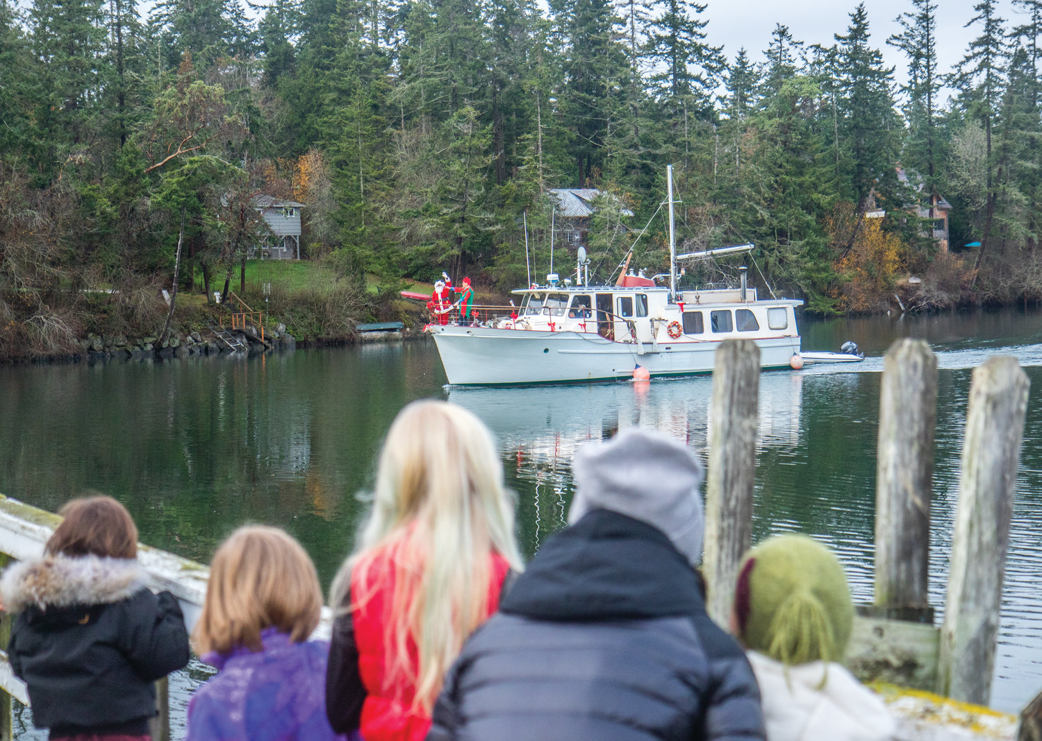 Santa Claus arrives at Marrowstone Island every winter by boat. For the past 20 years, he's hitched a ride on the 1963 boat, Pelican Point, captained by Larry Fay and Martha Ashman.
