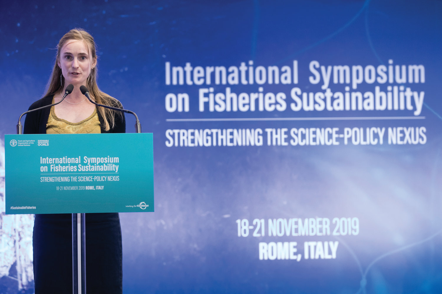 Above: At the podium of the United Nations' Food and Agricultural Organization (FAO) symposium on sustainable fisheries in Rome, Nov. 18, Port Townsend commercial fisher Rebecca Argo encouraged policies that favor owner-operators and indigenous fishers in the Alaska salmon fishery.
