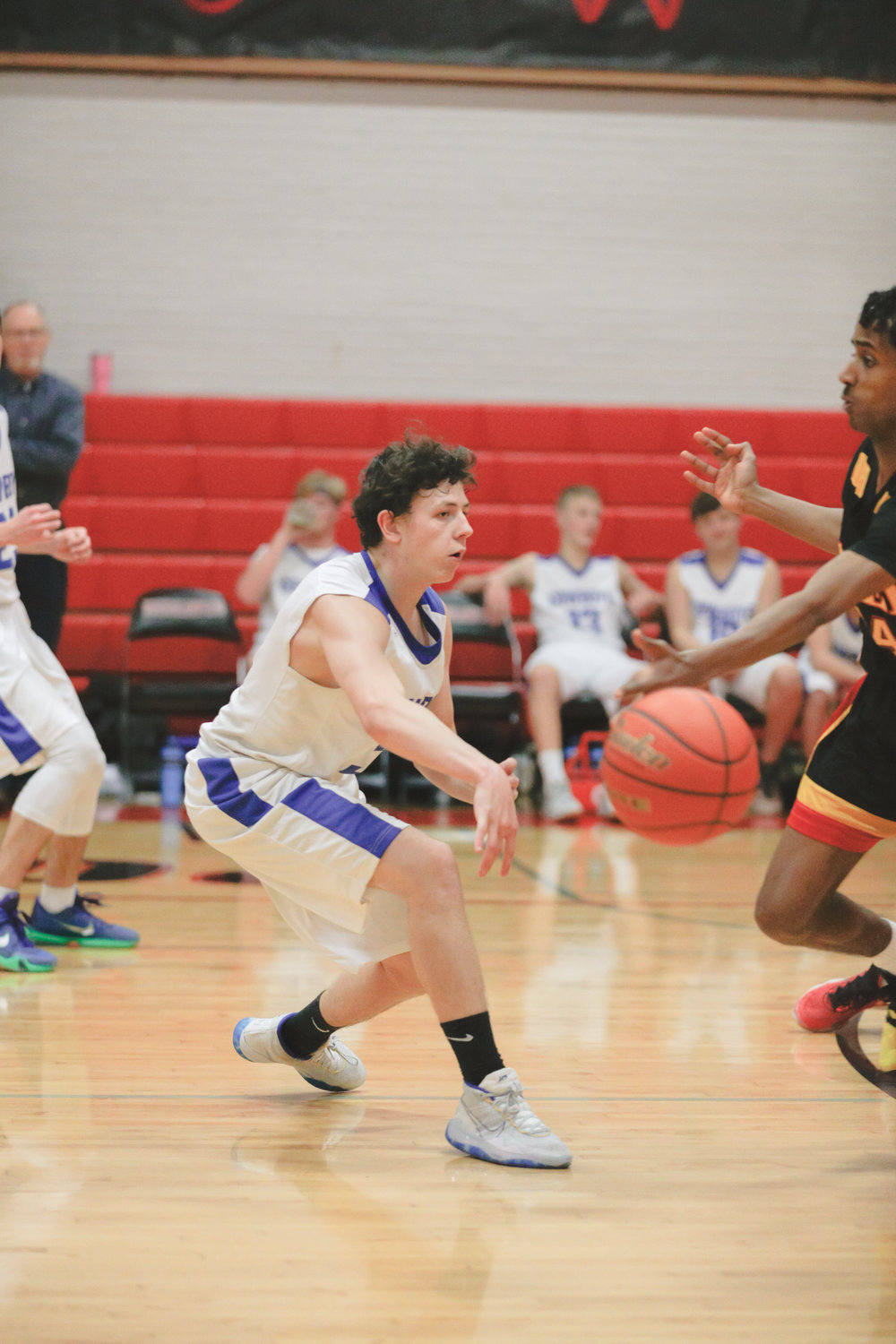 Chimacum guard Clayton Smith misdirects a defender with a no-look pass to teammate Tanner Carstensen.
