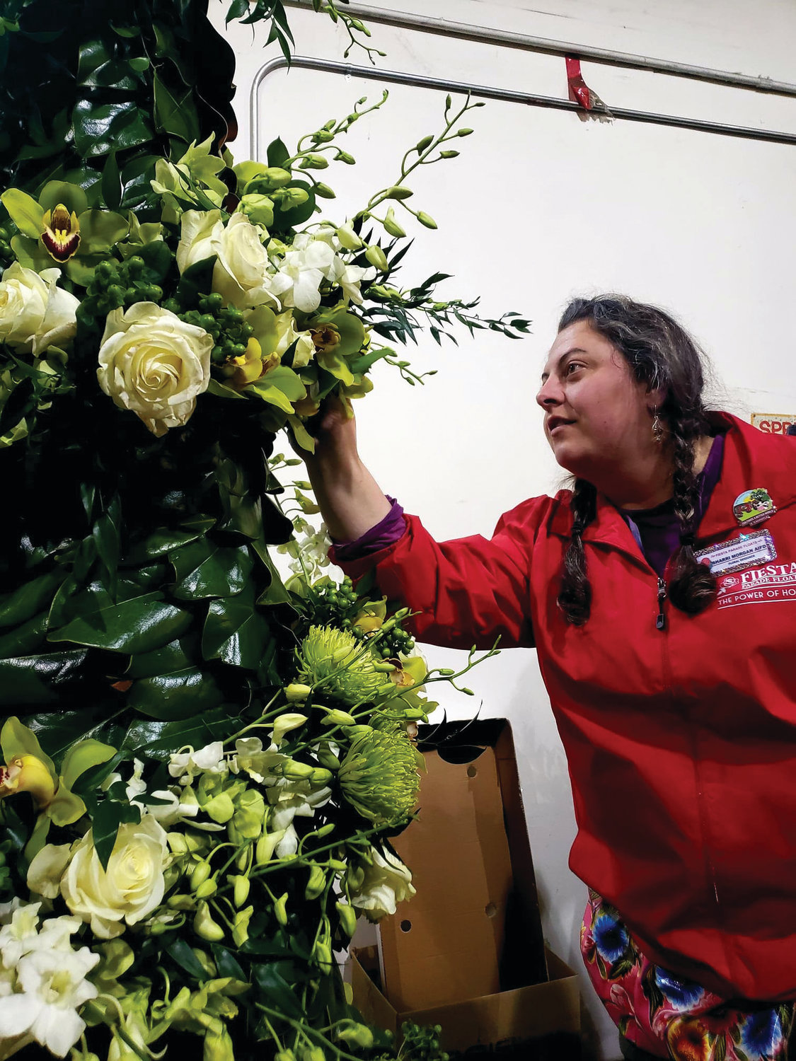 Sharrai Morgan inspects the floral arrangements of the float she and her team worked on non-stop from Dec. 26-31.