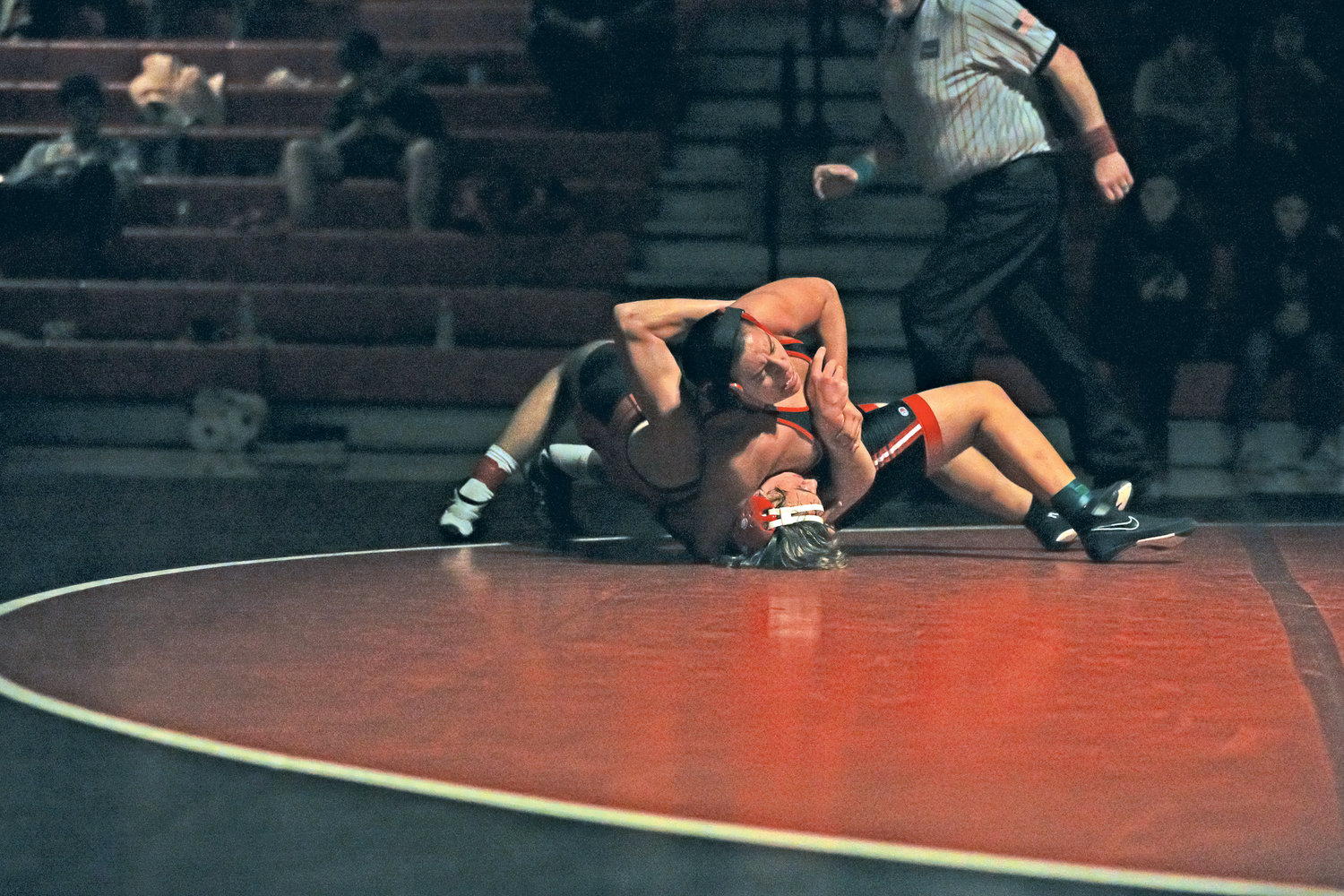 With his opponent in a headlock, Redhawks wrestler Exael Hernandez rests his weight on his opponent's chest to put a drain on his energy.