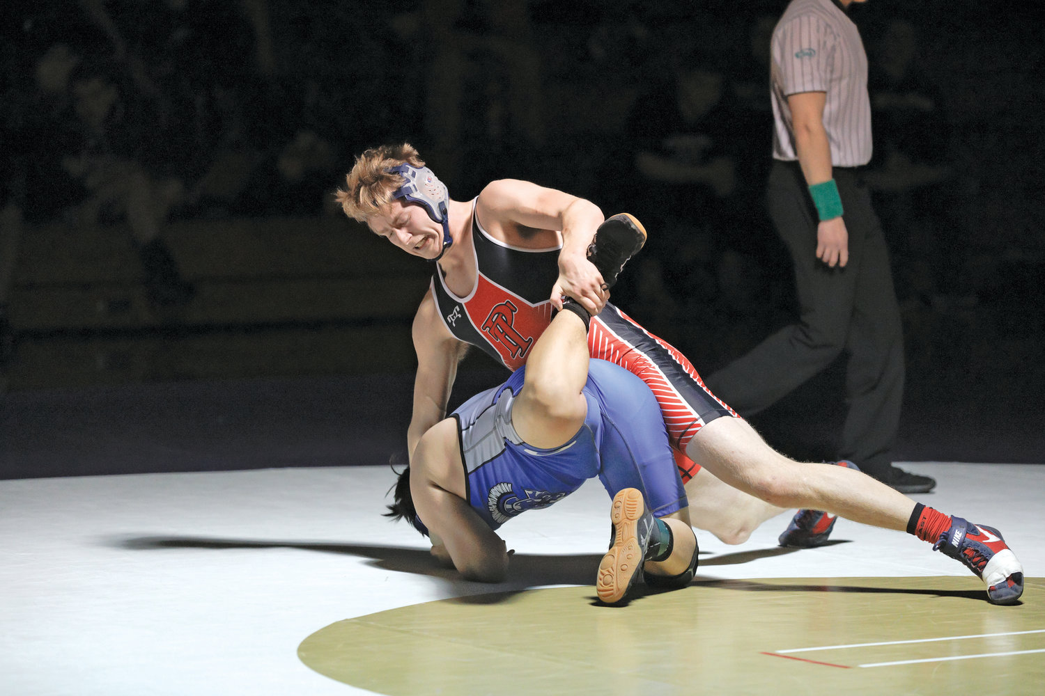Head down, leg up, Port Townsend's Wes Blue manipulates his opponent's body like a toy figurine.
