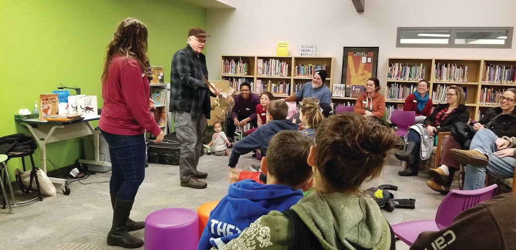 Faith Pray and Richard Jesse Watson serve as storytellers and discussion facilitators for the Prime Time Family Reading partnership between the Chimacum School District, the Jefferson County Library and Humanities Washington, seen here at the Chimacum Elementary Library on Jan. 23.