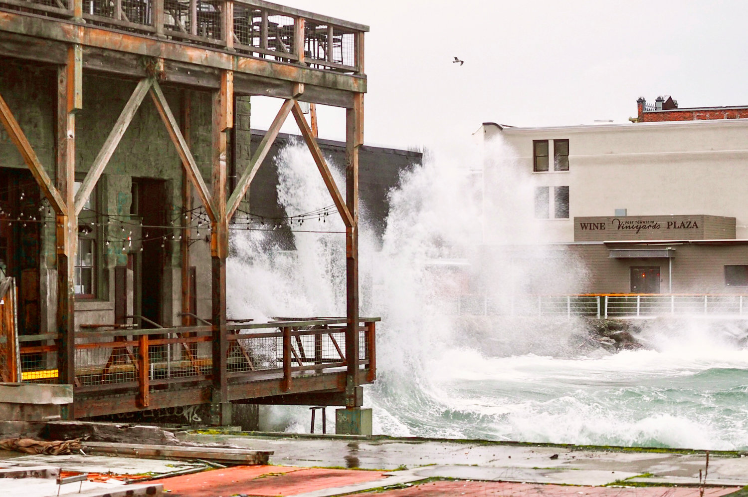 In this photo, captured by freelance maritime journalist Dieter Loibner on the morning of Jan. 29 during an 8.9-foot high tide, under a low-pressure system and with south winds whipping the crests, the waters of Port Townsend Bay are seen crashing against the sea-facing foundations of Water Street.