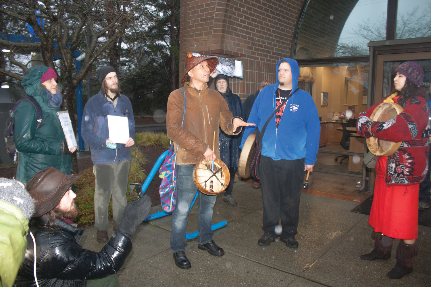Paul Chiyokten Wagner of the Redmond-based Saanich First Nations and founder of the Protectors of the Salish Sea leads a group of natives and allies in speeches and protest songs outside the Chase Bank branch on Kearney Street Feb. 5.