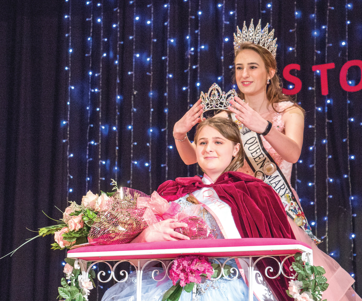 Jenessah Seebergoss is crowned the 2020 Rhody Festival queen by 2019 Queen Mary Neville at the coronation ceremony Feb. 8.